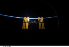 STS-119, Her Solar Panels Unfurled, the ISS at Dawn
