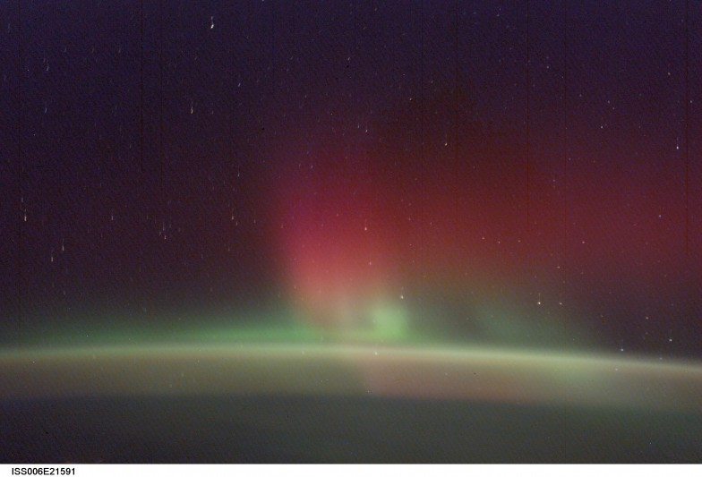 Photo courtesy of NASA.  This image, taken from the International Space Station in February 2, 2003 shows green and red aurora.  Depending on conditions, the ISS can travel through, above, or below aurora.